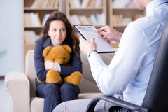 The woman with bear toy during psychologist visit Royalty Free Stock Image