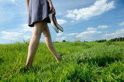 Woman Bearfoot Walk In Grass Royalty Free Stock Image