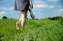 Free Woman Bearfoot Walk In Grass Stock Photo - 117725900