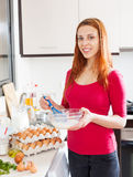 Woman beating eggs and milk in  bowl Royalty Free Stock Photos