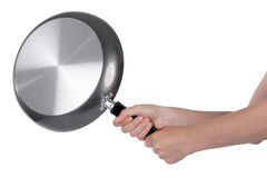 Woman beating with a frying pan. Isolated on white Stock Photo