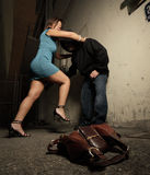 Woman beating up the assailant Royalty Free Stock Images