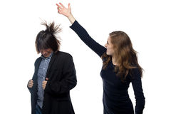 Woman beating young man Stock Photo