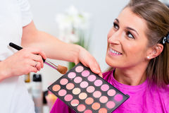 Woman with beautician in cosmetic salon Royalty Free Stock Photos
