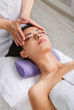 Woman beautician doctor make head massage in spa wellness center. Head and face pummeling massage in spa. Female beautician work in wellness center. Professional royalty free stock photos