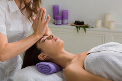 Woman beautician doctor make head massage in spa wellness center. Head and face pummeling massage in spa. Female beautician work in wellness center. Professional stock image