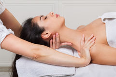 Woman beautician doctor make neck massage in spa wellness center. Female beautician doctor with patient in spa wellness center. Professional cosmetologist make stock photo