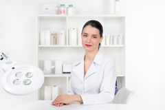 Woman beautician doctor at work in spa center. Portrait of a you stock image