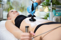 Woman at beautician`s getting thermaslim lavatron therapy Stock Images