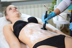 Woman at beautician`s getting thermaslim lavatron therapy Royalty Free Stock Images