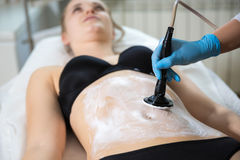 Woman at beautician`s getting thermaslim lavatron therapy Stock Image
