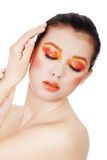 Woman with beautiful art orange abstract make-u Stock Image