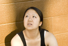 Woman beautiful athlete looking upward, failure Royalty Free Stock Image