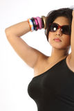 woman with beautiful bangles and sun glasses Stock Image