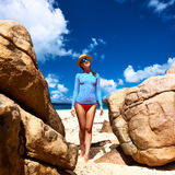 Woman at beautiful beach wearing rash guard Royalty Free Stock Photography