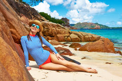 Woman at beautiful beach wearing rash guard Stock Images