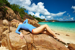 Woman at beautiful beach wearing rash guard Stock Photos