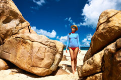 Woman at beautiful beach wearing rash guard Stock Image