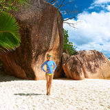 Woman at beautiful beach wearing rash guard Royalty Free Stock Photo