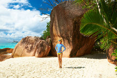 Woman at beautiful beach wearing rash guard Royalty Free Stock Image