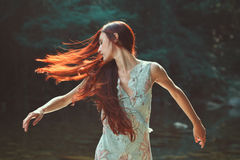 Woman with beautiful blowing hair stock photography