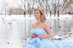 Woman in a beautiful blue dress in a winter Royalty Free Stock Images