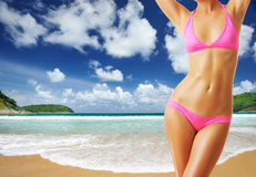 Woman with beautiful body at beach Stock Photos