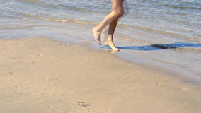 Woman with beautiful body. On the beach stock footage