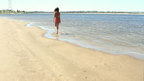 Woman with beautiful body on the beach. At sunny day stock footage