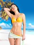 Woman with beautiful body in bikini at beach Royalty Free Stock Photography