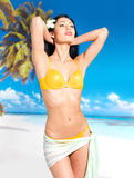 Woman with beautiful body in bikini at beach Royalty Free Stock Photography