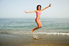 Woman with beautiful body jumping in a tropical beach Stock Photo