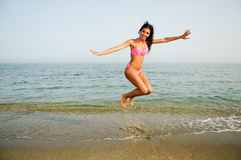 Woman with beautiful body jumping in a tropical beach Stock Photography