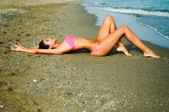 Woman with beautiful body on a tropical beach Royalty Free Stock Photos