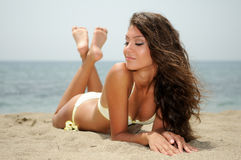 Woman with beautiful body on a tropical beach Stock Photos