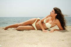 Woman with beautiful body on a tropical beach Stock Image
