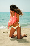 Woman with beautiful body on a tropical beach Stock Images