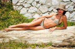 Woman with beautiful body wearing bikini and sun hat Royalty Free Stock Image