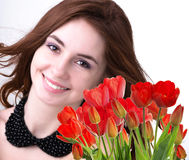 Woman with Beautiful bouquet fresh red tulips Royalty Free Stock Image