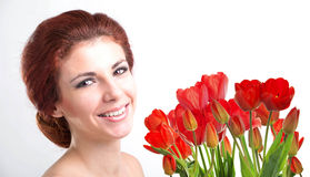 Woman with Beautiful bouquet fresh red tulips Stock Photo