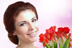 Woman with Beautiful bouquet fresh red tulips Stock Images