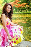 Woman with beautiful colorful dress near lake. Young woman with beautiful colorful dress outdoor royalty free stock image