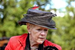 Woman in beautiful costume with hat at the annual castles horse ride. Stock Image