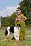The woman in a beautiful dress with borzoi Stock Image