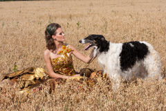 The woman in a beautiful dress with borzoi Stock Photography