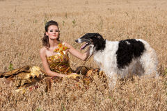The woman in a beautiful dress with borzoi Royalty Free Stock Images