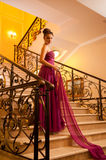 Woman in a beautiful dress sloit on the stairs Royalty Free Stock Photo