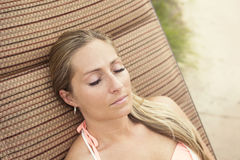 Woman with beautiful eyelashes lounging by the pool outdoors Stock Images