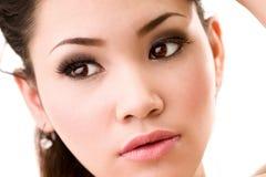 Woman beautiful eyes. Woman beautiful brown eyes looks ahead Royalty Free Stock Photography