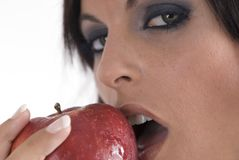 Woman with beautiful eyes eating an apple Stock Images